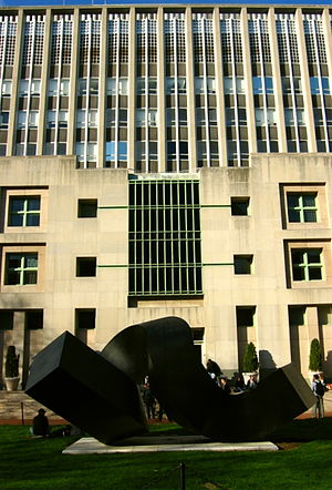 "Columbia Business School - Uris Hall, standing behind Clement Meadmore's 1968 sculpture ""The Curl"""