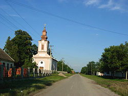 Vatin, main street and Orthodox church.jpg