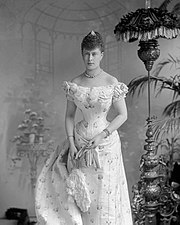 Young Mary in a tightly-corseted dress