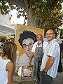 Vincent Sarrazin Peintre devant son portrait de Tignous.jpg