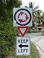 Virgin Gorda, British Virgin Islands — Road traffic signs (roundabout, yield, keep left).JPG