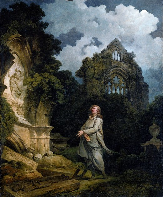 Visitor to moonlit churchyard