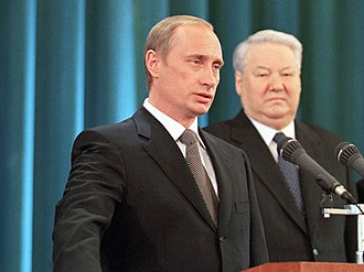 Political career of Vladimir Putin - Putin taking the presidential oath with Boris Yeltsin looking on (7 May 2000)