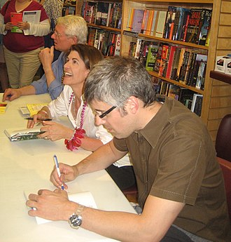 Wait Wait... Don't Tell Me! - Regular Wait Wait... panelists (l–r) Roy Blount Jr., Amy Dickinson, and Mo Rocca sign autographs following a March 2010 taping in New Orleans