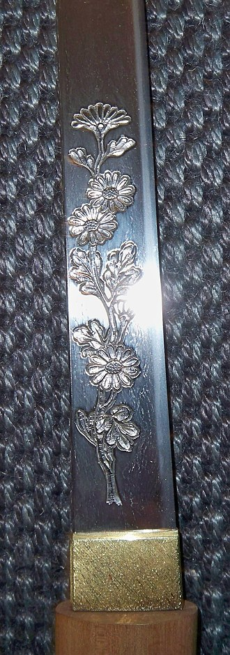 Horimono - Antique Japanese wakizashi sword blade showing the horimono, of a chrysanthemum.