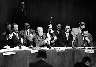 Warren Austin holds up Soviet SMG at UN HD-SN-99-03037.JPEG
