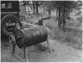 Wild rice hulling machine set up at the camp - NARA - 285214.tif