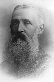 Portrait of an older man with a long beard