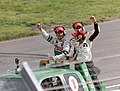Winner Sebastien Bourdais, 2nd placed Bruno Junqueira & 3rd placed Mario Dominguez take a lap of honour at the 2003 Champcar London Trophy race (50813831596).jpg