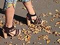 Woman-Walking-in-Park Autumn-Yellow-Leaves High-Heels legs and Feet (8426235590).jpg