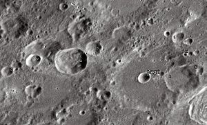 "Zagut (crater) - Zagut crater and its satellite craters taken from Earth in 2012 at the University of Hertfordshire's Bayfordbury Observatory with the telescopes Meade LX200 14"" and Lumenera Skynyx 2-1"