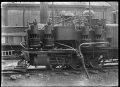 """""""R"""" class Fairlie steam locomotive rigged with air compressors, at the Petone Railway Workshops. ATLIB 288272.png"""