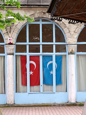 East Turkestan independence movement - Flags of Turkey and Eastern Turkestan at Doğu Türkistan Vakfı-Kültür Merkezi (Eastern Turkistan Foundation-Cultural Center) in Fatih district, Istanbul