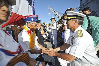 442nd Infantry Regiment (United States) - Pearl Harbor (July 2, 2014). Adm. Harry Harris Jr., commander of the U.S. Pacific Fleet, thanks Ralph Tomei, a 442nd Regimental Combat Team veteran, for his contributions during World War II. Tomei represented his friend Shiro Aoki as Rear Adm. Anne Cullere, commander in chief of French forces in the Pacific, presented him with the French Nation Order of the Legion of Honor aboard the French Floréal-class frigate FS Prairial. For more than a decade the government of France has presented the Legion of Honor to U.S. veterans who participated in the liberation of France during World War II.