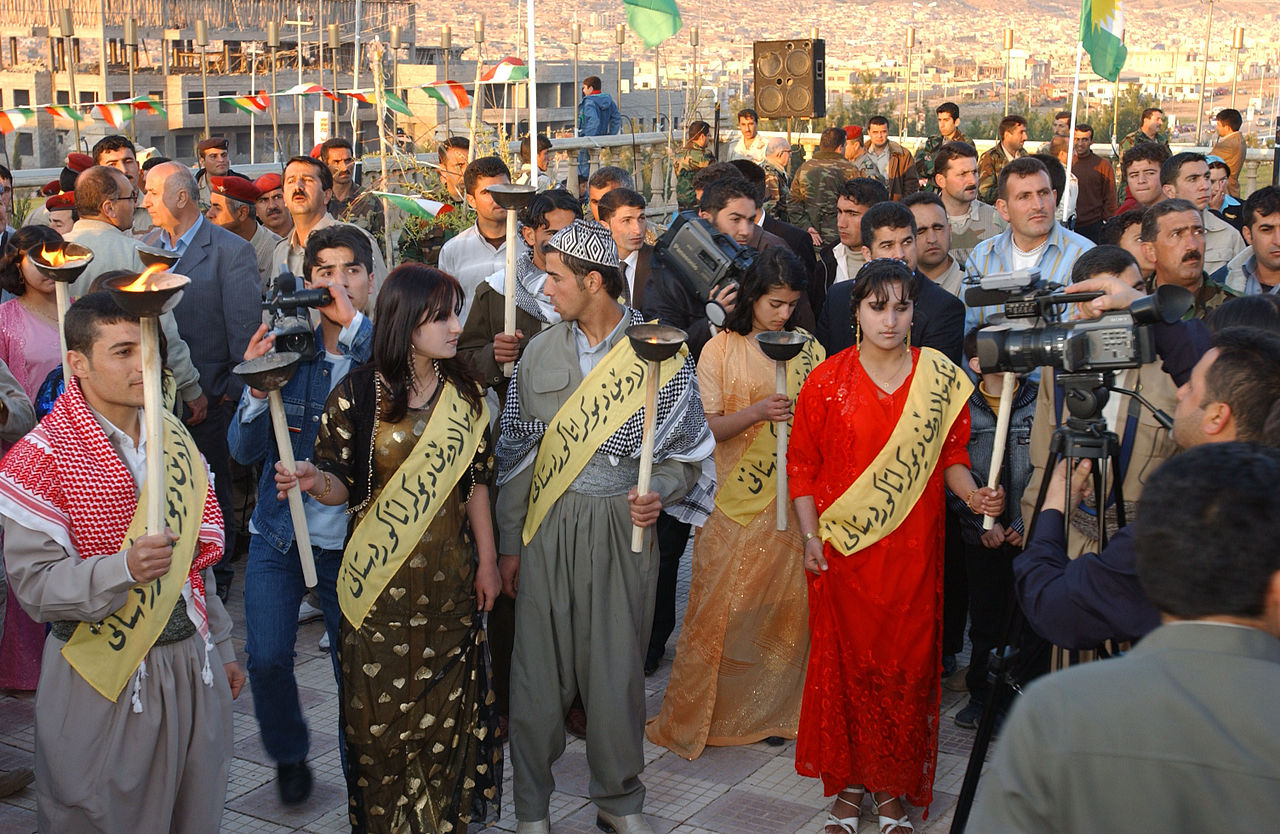 17338 A group of Dahuk, Iraq residents wait for speeches after walking in the Kurdish News Years Parade in 2006.jpg