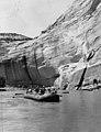 1953 Sierra Club Green River Canyon Trip. Sierra Club members in inflatable pontoon boatraft passing by an overhanging cliff (c0fcdba7be324aa3bf2eb0e34e337b3d).jpg