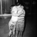 1960 robert hugging brad phillips.png