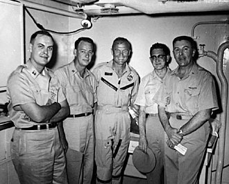 USS Randolph (CV-15) - Medical debriefing of Major John H. Glenn, Jr., USMC (center) after orbital flight of Friendship 7 on 20 February 1962 aboard Randolph
