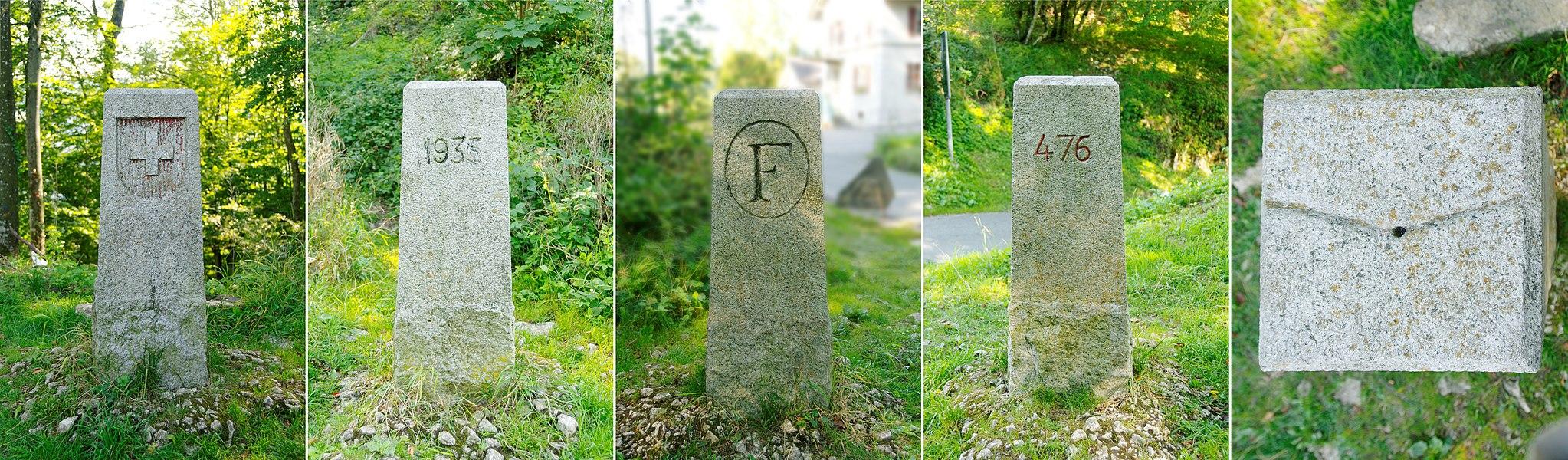 Borne frontière franco-suisse. De gauche à droite:    côté suisse  année de mise en place de la borne  côté français  numéro de la borne  sillon sommital