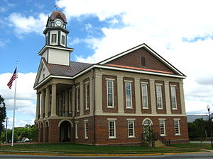 Pittsboro, North Carolina - Viewed from the west-northwest, the Chatham County Court House in August 2013, having been rebuilt after a fire destroyed the upper floors and clock tower.