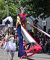 2018 Fremont Solstice Parade - 007-stilters and bead-thrower (28548617697).jpg