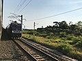201908 HXD1C-0020 hauls Freight Train Approaches to Baishiyi Station.jpg