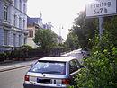 Puschkinpromenade: Abschnitt der Straße Puschkinpromenade zwischen Friedrich-Ebert-Straße und Zimmerstraße einschließlich der Bebauung an der Nordseite der Straße mit den typischen Vorgärten und deren Einfriedungen sowie dem Altbaumbestand