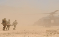 306 Rescue Squadron PJs evacuate simulated casualty to 305 Rescue Squadron HH-60.png