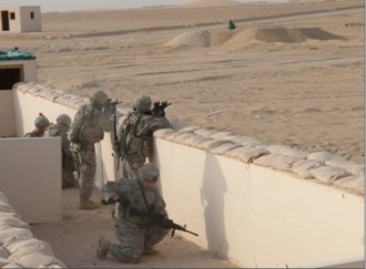 118th Infantry Regiment (United States) - Soldiers of A Company, 4th Battalion, 118th Infantry Regiment engage targets after assaulting and clearing a trench system, one of their objectives during a platoon live-fire exercise at the Udairi Range Complex in northern Kuwait, July 31, 2012. The Soldiers also cleared buildings during the exercise. In addition to undertaking camp and security-force operations, the South Carolina Army National Guard Soldiers have kept up the pace of their training since deploying to Kuwait in April.