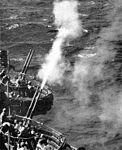 40mm guns firing on USS Attu (CVE-102) 1944.jpg