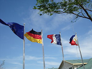 European International School - The flags of Germany, France, the Philippines, and the European Union hoisted at the EIS