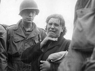 A Polish woman weeps as she tells American soldiers of her life as a slave laborer for the Nazis. She was liberated in Augsburg when the third largest Bavarian city fell to the Americans April 23, 1945. A-Polish-woman-weeps-as-she-tells-her-story-to-US-troops-142365089506.jpg