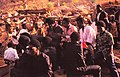 ASC Leiden - W.E.A. van Beek Collection - Dogon markets 26 - A group of agemates drinking, Tireli, Mali 1996.jpg