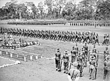 Soldiers marching around a parade ground