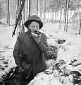 A British soldier eats his midday meal in a trench in the snow, while manning part of the front line along the River Maas in Holland, 8 January 1945. BU1598.jpg