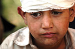 A Pakistani Boy Waits to Board an MH-53 Sea Stallion Helicopter to Be Evacu DVIDS11443.jpg