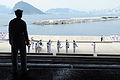A U.S. Sailor aboard USS Ronald Reagan (CVN 76) watches members of a South Korean navy band play as the ship arrives in Busan, South Korea, July 14, 2008 080714-N-HX866-001.jpg
