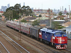 V/Line H type carriage - H type carriage set led by an A class locomotive with a power van at West Footscray in September 2006