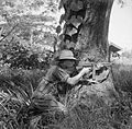 A fusilier of the Royal Scots provides covering fire with his Thompson sub-machine gun in the village of Namma in Burma, October 1944. SE2989.jpg