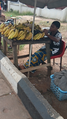 A young Nigerian girl selling Bananas.png