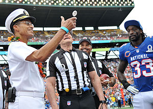 American football rules - Cecil D. Haney clips the coin at the 2013 Pro Bowl.