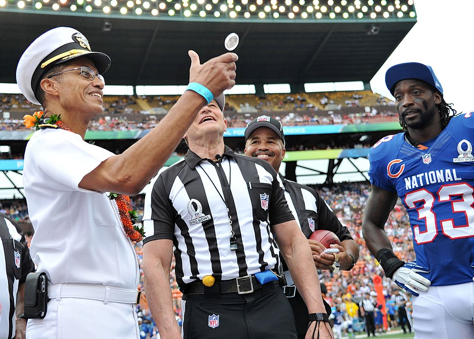 Adm. Haney flips the coin at the Pro Bowl