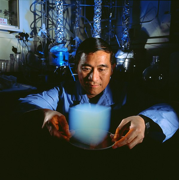 Aerogel cube & Peter Tsou, JPL Scientist, Stardust Deputy Principal Investigator. Image courtesy NASA via Wikimedia Commons.