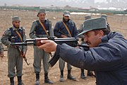 An Afghan National Police instructor using an AKS.