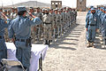 Afghan Border Police and Afghan Uniform Police recruits stand at attention during the Afghan national anthem at their graduation ceremony in Spin Boldak, Afghanistan, March 14, 2012 120314-F-FR276-028.jpg