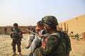 Afghan National Army (ANA) commandos play with a child April 1, 2012, during a patrol in Panjwai district, Kandahar province, Afghanistan 120401-A-NC985-037.jpg
