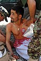 Afghan National Army soldiers treat a casualty during the Combat Medic Course at the Regional Military Training Center Kandahar.jpg