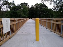 Wooden Bridge with one yellow pole