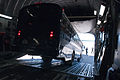 Airmen download bus from C-17 120611-A-WZ615-181.jpg