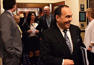 Donny Olson - Senators leaving the House chambers at the Alaska State Capitol following a joint session on gubernatorial appointments on April 19, 2015.  Olson is in the foreground.